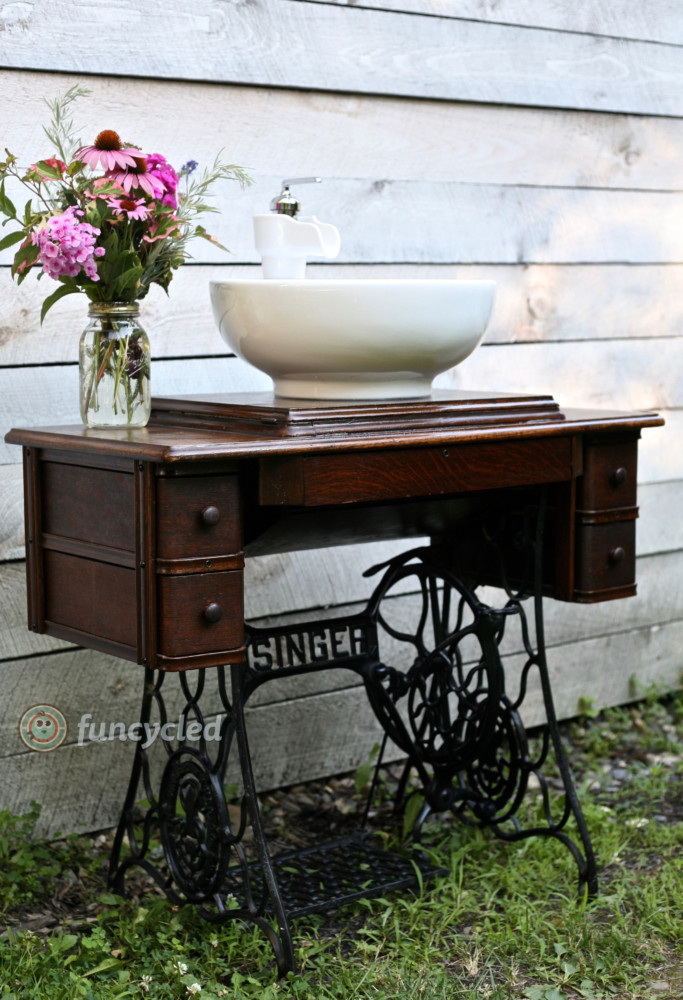A Graphic Light Box And A Mid Century Dresser Turning The: Singer Sewing Machine Repurposed Into A Bathroom Sink